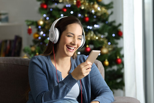 Woman listening to music on christmas