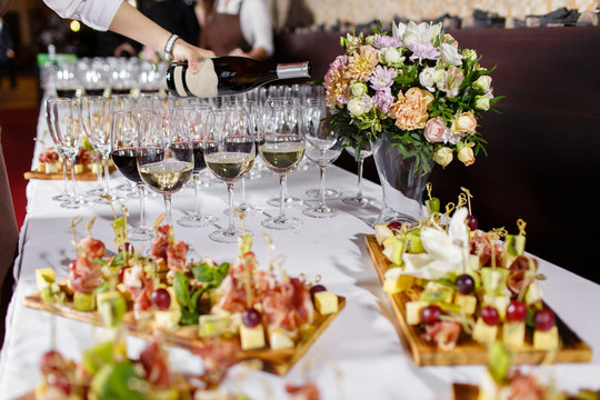 Waiter pouring champagne in the party event. Reception at the wedding party or Banquet for the anniversary