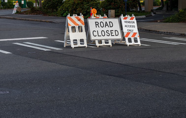Road closed signs and barricades placed on a crosswalk