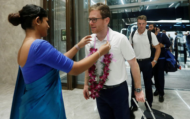 England captain Morgan receives a flower garland as he arrives at the Shangri-La hotel in Colombo