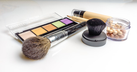 Makeup, cosmetics products on light background. Top view. Decorative cosmetics and accessory with empty space.