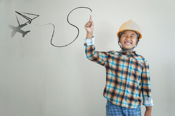Little boy engineering with creative drawing of airplan.