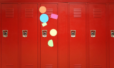 Colorful stickers on red lockers in the school
