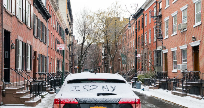 I love NY written in snow on a car parked in the Greenwich Village neighborhood of Manhattan after a winter storm in New York City