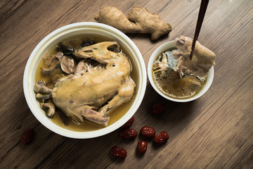chicken soup with wooden background