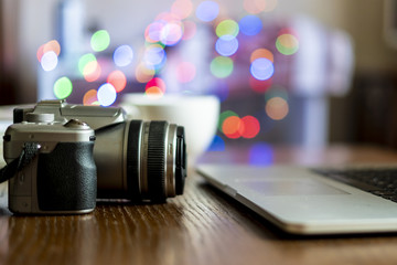 close up camera on the table of photographer workplace with laptop f