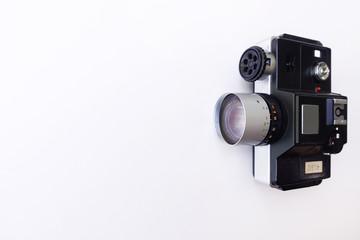 Retro film photo camera isolated on white background
