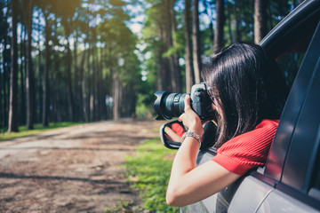 female traveler take a photograph.
