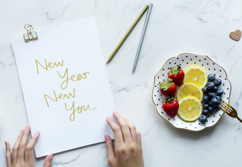 Woman writing New Year New You