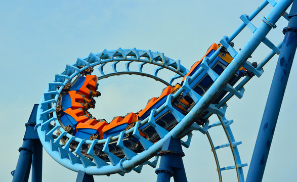 Roller coaster  ride filled  with thrill seekers doing
