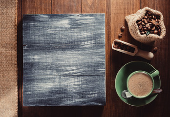 coffee cup and  beans on wood