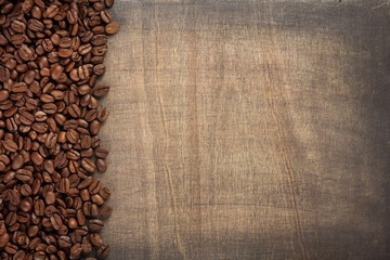 coffee beans at wooden background