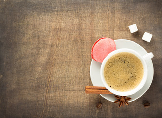 cup of coffee and ingredients on wooden background