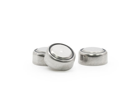 Button cell on isolated background. Small watch lithium battery ( Clipping path or cutout object for montage )