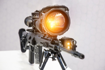 Rifle with a gun with a magnifying and infrared scope.