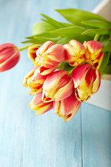 Bunch of Tulips on a Tray. Flower background. Wooden background. Copy space.