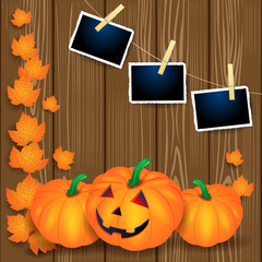Halloween illustration with pumpkins, leaves and photo frames on wooden background
