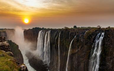 Victoria falls dreamy sunset panorama with orange