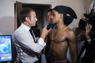 French President Emmanuel Macron speaks with a youth in the Quartier Orleans during a visit to the French Caribbean island of Saint-Martin