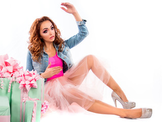 Cute doll in a pink dress and jeans jacket