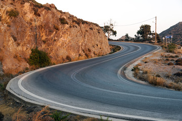 A view of a curved road and  in the island of Patmos, Greece