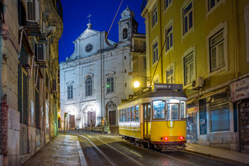 tram on line 28 in lisbon, portugal at night
