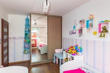 Kids bedroom interior with pastel color wallpapers
