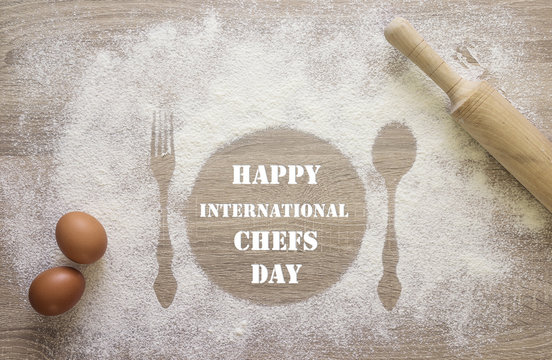 International Chef day greeting card. Prints of dish, fork and spoon in the flour with uncooked eggs and rolling pin.