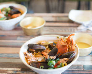 Seafood Meal for Two. Fresh Food in a Bowl. Healthy Food Restaurant. Health and Diet Nutrition. Asian Crab, Mussels, Shrimp Soup. Salt, Spices, Herbs, Vegetables. Seafood Dish. Cuisine Lunch Sauce.
