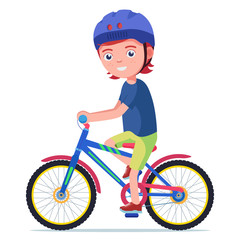 Boy rides a bicycle in a protective helmet
