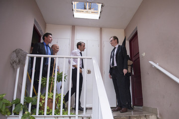 French President Emmanuel Macron leaves an appartment in the Quartier Orleans during a visit to the French Caribbean island of Saint-Martin