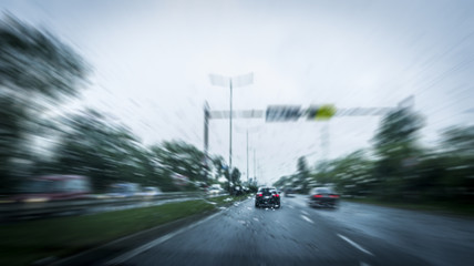 fast-moving cars on the highway and blurry effect. blurry effect of high speed car. driving at an unlicensed speed.Drunk driving a car in rainy weather.