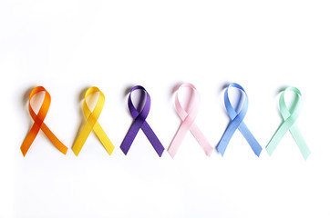 Set of multiple awareness ribbons, six different colors that symbolize different charitable events, causes, associations & help draw attention to numerous illnesses. Background, copy space, flat lay
