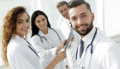 Portrait of aged male doctor teaching medical students.