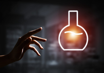 Science and research concept with tube symbol on dark interior background
