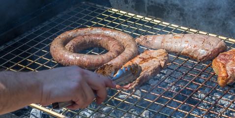 Meat on the grill in a traditional South African braai image with copy space in landscape format