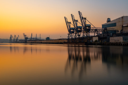 Cranes along the River Nervion in the industrial North of Bilbao, Basque Country, Spain