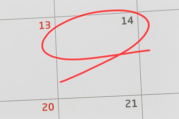 Focus on number 14 in calendar and empty red ellipse.
