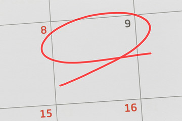 Focus on number 9 in calendar and empty red ellipse.