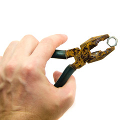 The old pliers in the hand are insulated.