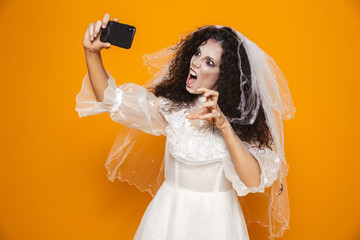 Scary creepy bride making selfie isolated