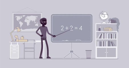 Male teacher stands at the blackboard