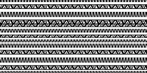 Tribal pattern vector with black and white hand drawn ethnic symbol. Abstract african ancient drawing background ready for fashion textile print and wrapping.