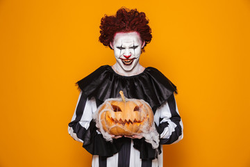 Mad man dressed in scary clown Halloween costume