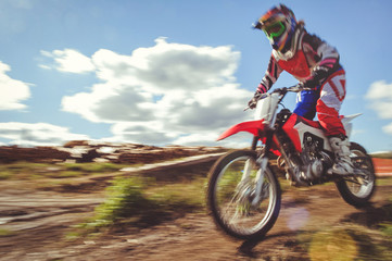 woman on enduro motocross in motion, desire for victory, dynamics of speed
