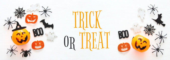 Halloween holiday concept over white wooden background. Top view, flat lay banner.