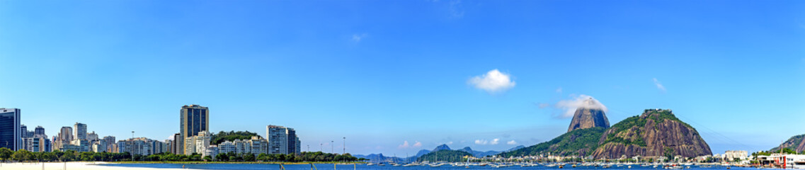 Panoramic morning view of the beach and Botafogo cove with its buildings, Sugar Loaf hill, boats and mountains in Rio de Janeiro Wall mural
