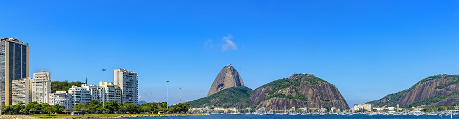 Panoramic morning view of the beach and Botafogo cove with its buildings, Sugar Loaf hill, boats and mountains in Rio de Janeiro