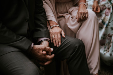 woman having hand on the leg of her husband