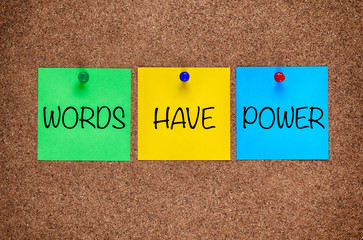 Phrase Words Have Power on corkboard.